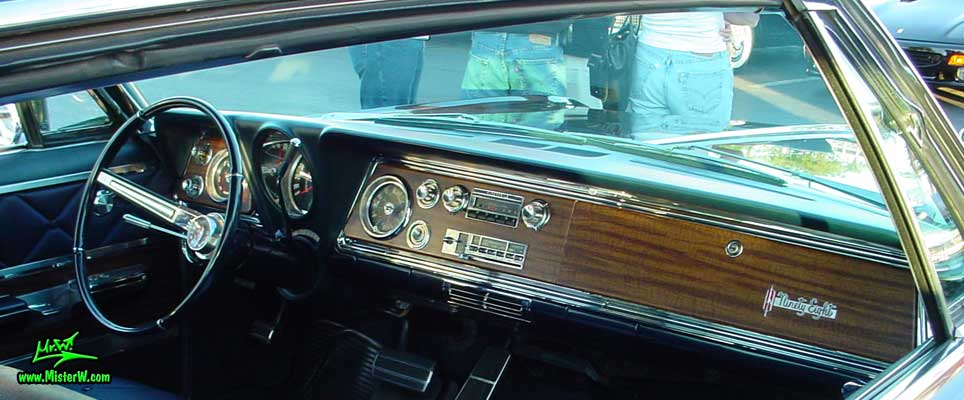 Photo of a dark blue 1966 Oldsmobile Ninety Eight 2 Door Hardtop Coupe at the Scottsdale Pavilions Classic Car Show in Arizona. 1966 Oldsmobile 98 Dash Board