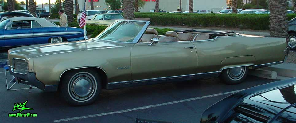 Photo of a gold 1969 Oldsmobile 2 Door Convertible at the Scottsdale Pavilions Classic Car Show in Arizona. 69 Olds