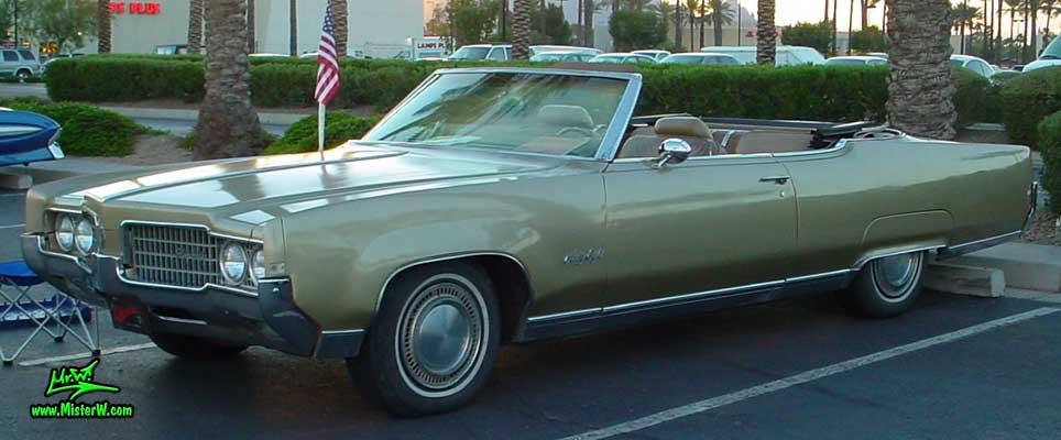 Photo of a gold 1969 Oldsmobile 2 Door Convertible at the Scottsdale Pavilions Classic Car Show in Arizona. 1969 Olds Convertible