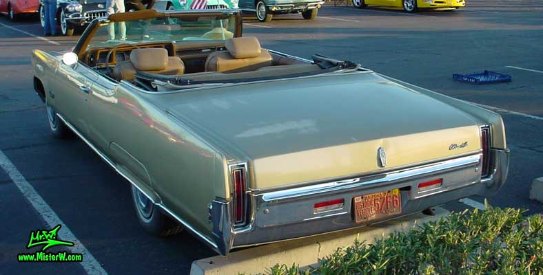 Photo of a gold 1969 Oldsmobile 2 Door Convertible at the Scottsdale Pavilions Classic Car Show in Arizona. 69 Olds Convertible Tail Lights & Bumper