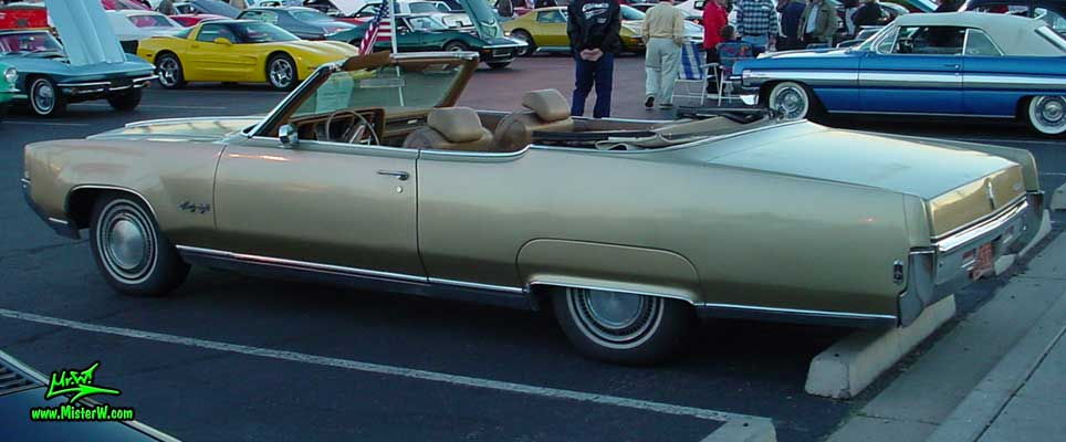 Photo of a gold 1969 Oldsmobile 2 Door Convertible at the Scottsdale Pavilions Classic Car Show in Arizona. 1969 Oldsmobile Convertible Sideview