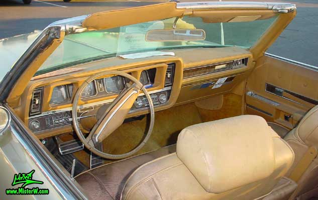 Photo of a gold 1969 Oldsmobile 2 Door Convertible at the Scottsdale Pavilions Classic Car Show in Arizona. 1969 Oldsmobile Odometer & Dash Board