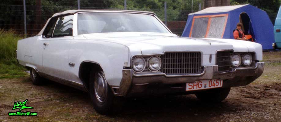 Photo of a white 1969 Oldsmobile Ninety Eight 2 Door Convertible at a Classic Car Show in Germany. 69 Olds Ninety Eight Convertible