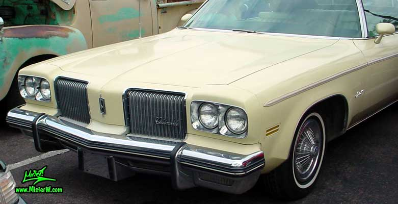 Photo of a beige 1974 Oldsmobile Royale 2 Door Convertible at the Scottsdale Pavilions Classic Car Show in Arizona. 74 Olds