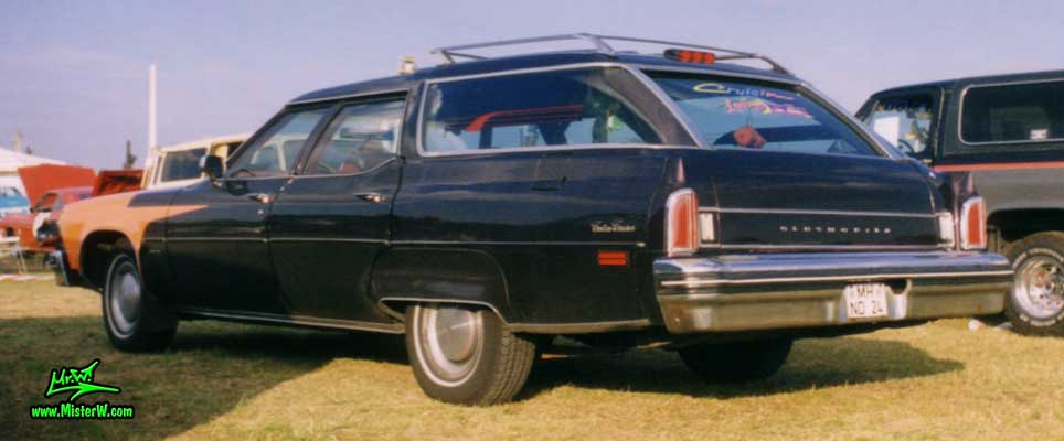 Photo of a black 1976 Oldsmobile Custom Cruiser 4 Door Station Wagon at a Classic Car Meeting in Germany. 1976 Oldsmobile Station Wagon