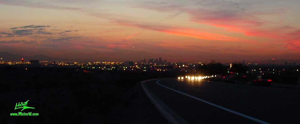 Photo of the Sunset Skyline of Downtown Phoenix, taken from East Mc Dowell Road at the Papago Mountain Park in spring 2001 Sunset in Phoenix, Arizona