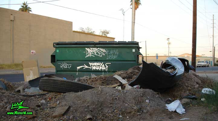 Photo of a dumpster & trash in Downtown Phoenix, Arizona, summer 2007 Bates tag on a ghetto dumpster in Phoenix, Arizona
