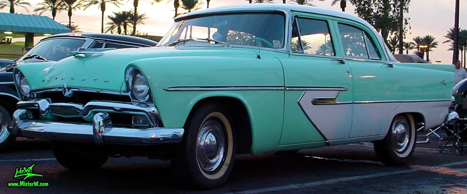 Photo of a white & turquoise 1956 Chrysler Plymouth Belvedere 4 Door Sedan at the Scottsdale Pavilions Classic Car Show in Arizona. 56 Plymouth Belvedere Sedan
