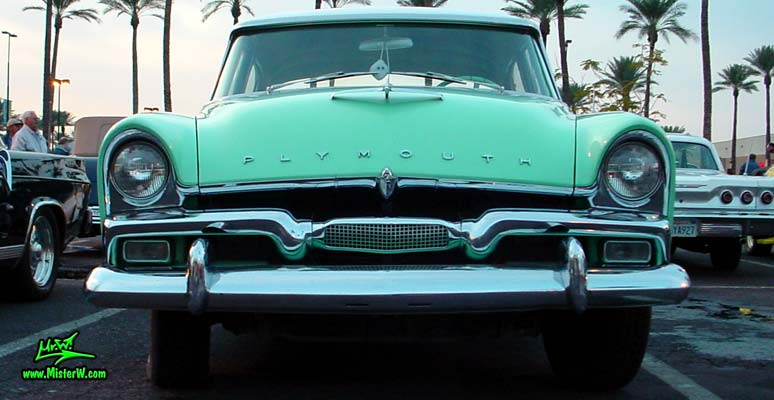 Photo of a white & turquoise 1956 Chrysler Plymouth Belvedere 4 Door Sedan at the Scottsdale Pavilions Classic Car Show in Arizona. Frontview of a 56 Plymouth Belvedere