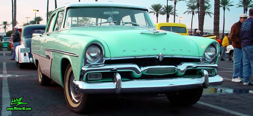 Photo of a white & turquoise 1956 Chrysler Plymouth Belvedere 4 Door Sedan at the Scottsdale Pavilions Classic Car Show in Arizona. 1956 Plymouth Belvedere