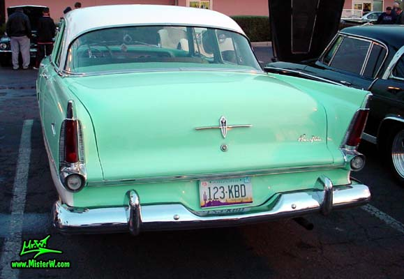 Photo of a white & turquoise 1956 Chrysler Plymouth Belvedere 4 Door Sedan at the Scottsdale Pavilions Classic Car Show in Arizona. Tail Fins of a 56 Plymouth Belvedere