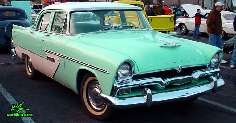 Photo of a white & turquoise 1956 Chrysler Plymouth Belvedere 4 Door Sedan at the Scottsdale Pavilions Classic Car Show in Arizona. 56 Plymouth Belvedere