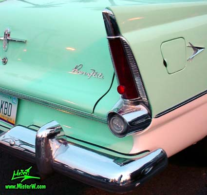 Photo of a white & turquoise 1956 Chrysler Plymouth Belvedere 4 Door Sedan at the Scottsdale Pavilions Classic Car Show in Arizona. Tail Fin of a 56 Plymouth