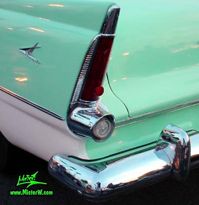 Photo of a white & turquoise 1956 Chrysler Plymouth Belvedere 4 Door Sedan at the Scottsdale Pavilions Classic Car Show in Arizona. Tail Light of a 56 Plymouth