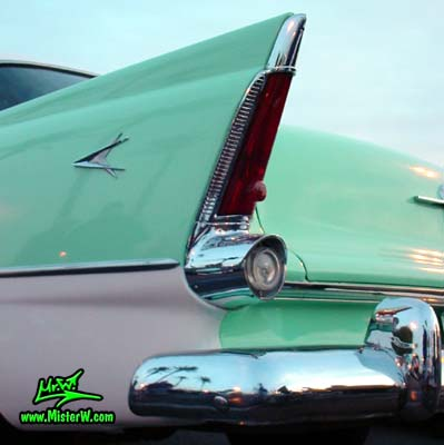 Photo of a white & turquoise 1956 Chrysler Plymouth Belvedere 4 Door Sedan at the Scottsdale Pavilions Classic Car Show in Arizona. Tailfin & Rear Light of a 56 Plymouth Belvedere