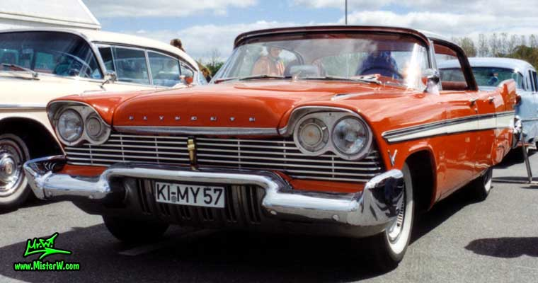 Photo of a red 1957 Chrysler Plymouth Belvedere 4 Door Hardtop Sedan at a Classic Car Meeting in Germany. Red 57 Plymouth