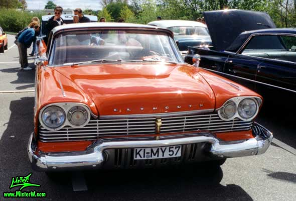Photo of a red 1957 Chrysler Plymouth Belvedere 4 Door Hardtop Sedan at a Classic Car Meeting in Germany. 1957 Plymouth Belvedere Sedan Chrome Grill