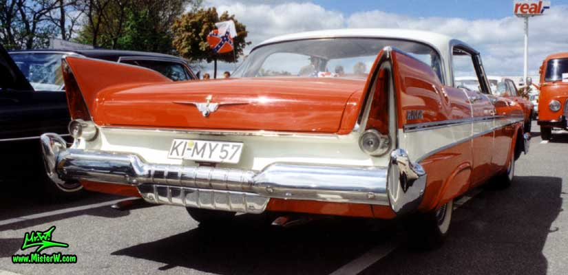 Photo of a red 1957 Chrysler Plymouth Belvedere 4 Door Hardtop Sedan at a Classic Car Meeting in Germany. 1957 Plymouth Belvedere Sedan Tail Fins