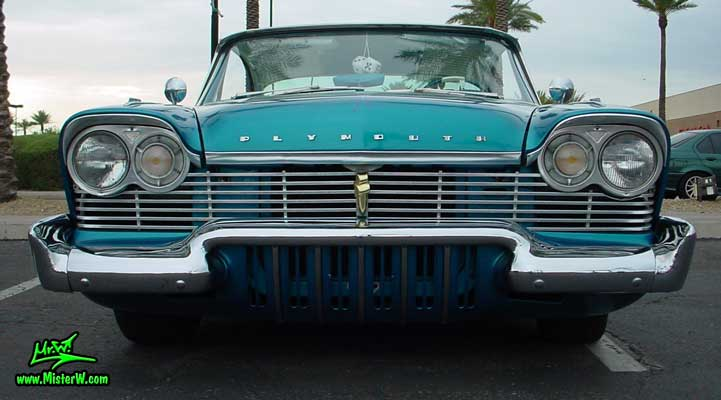 Photo of a turquoise 1957 Chrysler Plymouth Belvedere 2 Door Hardtop Coupe at the Scottsdale Pavilions Classic Car Show in Arizona. Chrome Grill of a 1957 Plymouth Belvedere Coupe