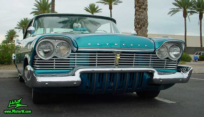 Photo of a turquoise 1957 Chrysler Plymouth Belvedere 2 Door Hardtop Coupe at the Scottsdale Pavilions Classic Car Show in Arizona. 1957 Plymouth Belvedere Coupe