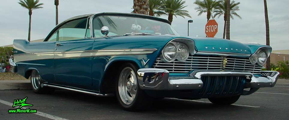 Photo of a turquoise 1957 Chrysler Plymouth Belvedere 2 Door Hardtop Coupe at the Scottsdale Pavilions Classic Car Show in Arizona. Lowered 1957 Plymouth Belvedere Coupe