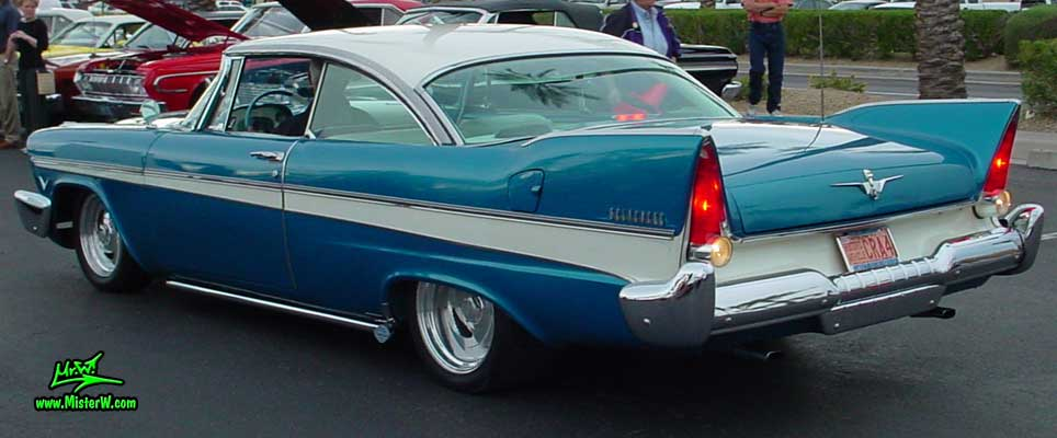 Photo of a turquoise 1957 Chrysler Plymouth Belvedere 2 Door Hardtop Coupe at the Scottsdale Pavilions Classic Car Show in Arizona. 1957 Plymouth Belvedere Coupe with Side Pipes