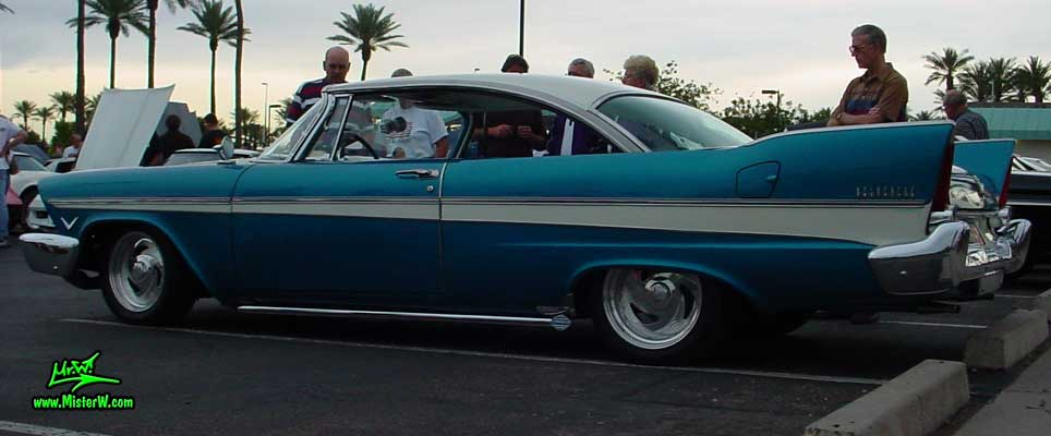 Photo of a turquoise 1957 Chrysler Plymouth Belvedere 2 Door Hardtop Coupe at the Scottsdale Pavilions Classic Car Show in Arizona. 1957 Plymouth Belvedere Coupe in Scottsdale, Arizona