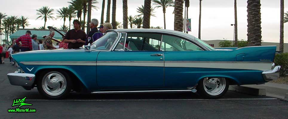 Photo of a turquoise 1957 Chrysler Plymouth Belvedere 2 Door Hardtop Coupe at the Scottsdale Pavilions Classic Car Show in Arizona. Sideview of a 1957 Plymouth Belvedere Coupe