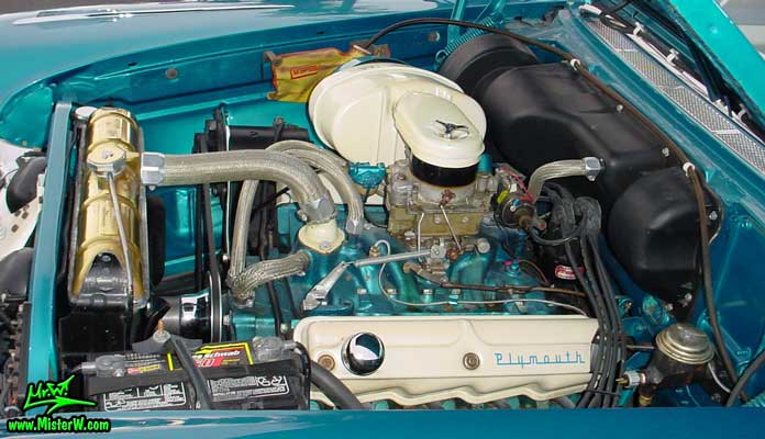 Photo of a turquoise 1957 Chrysler Plymouth Belvedere 2 Door Hardtop Coupe at the Scottsdale Pavilions Classic Car Show in Arizona. Engine of a 1957 Plymouth Belvedere Coupe