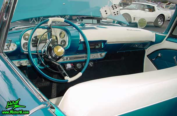 Photo of a turquoise 1957 Chrysler Plymouth Belvedere 2 Door Hardtop Coupe at the Scottsdale Pavilions Classic Car Show in Arizona. Interior & Dash Board of a 1957 Plymouth Belvedere Coupe