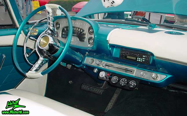 Photo of a turquoise 1957 Chrysler Plymouth Belvedere 2 Door Hardtop Coupe at the Scottsdale Pavilions Classic Car Show in Arizona. 1957 Plymouth Dashboard