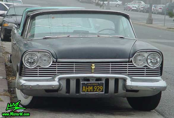 Photo of a flat black 1957 Chrysler Plymouth 2 Door Hardtop Coupe in San Francisco, California. Flat Black 1957 Plymouth Chrome Grill