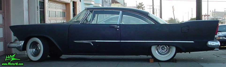 Photo of a flat black 1957 Chrysler Plymouth 2 Door Hardtop Coupe in San Francisco, California. Sideview of a Flat Black 1957 Plymouth Coupe