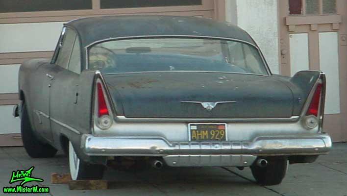 Photo of a flat black 1957 Chrysler Plymouth 2 Door Hardtop Coupe in San Francisco, California. Rearview of a flat black 1957 Plymouth