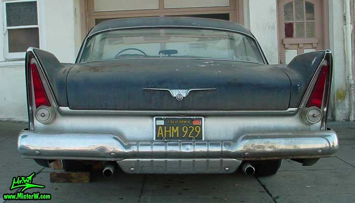 Photo of a flat black 1957 Chrysler Plymouth 2 Door Hardtop Coupe in San Francisco, California. Back of a flat black 1957 Plymouth Belvedere Coupe