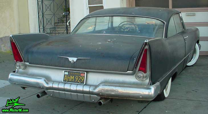 Photo of a flat black 1957 Chrysler Plymouth 2 Door Hardtop Coupe in San Francisco, California. Fins of a flat black 1957 Plymouth Coupe