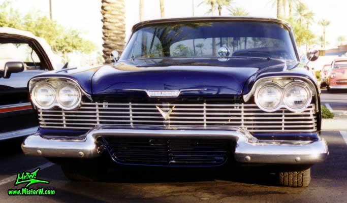 Photo of a blue 1958 Chrysler Plymouth Savoy 2 Door Hardtop Coupe at the Scottsdale Pavilions Classic Car Show in Arizona. 1958 Plymouth Savoy Chrome Grill