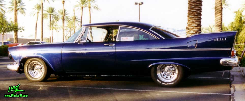 Photo of a blue 1958 Chrysler Plymouth Savoy 2 Door Hardtop Coupe at the Scottsdale Pavilions Classic Car Show in Arizona. Blue 1958 Plymouth Savoy Coupe