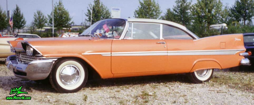 Photo of a salmon orange 1959 Chrysler Plymouth Belvedere 2 Door Hardtop Coupe at a classic car meeting in Germany. 1959 Plymouth Belvedere Coupe