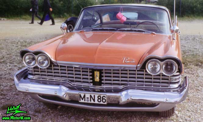 Photo of a salmon orange 1959 Chrysler Plymouth Belvedere 2 Door Hardtop Coupe at a classic car meeting in Germany. 1959 Plymouth