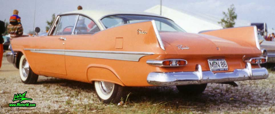 Photo of a salmon orange 1959 Chrysler Plymouth Belvedere 2 Door Hardtop Coupe at a classic car meeting in Germany. 1959 Plymouth Tail Fins