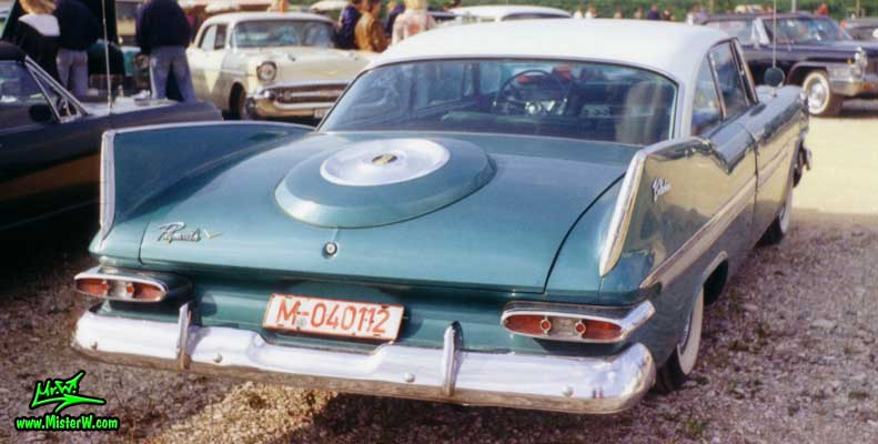 Photo of a turquoise 1959 Chrysler Plymouth Belvedere 2 Door Hardtop Coupe at a classic car meeting in Germany. Turquoise Tail Fins of a 1959 Plymouth Belvedere Coupe