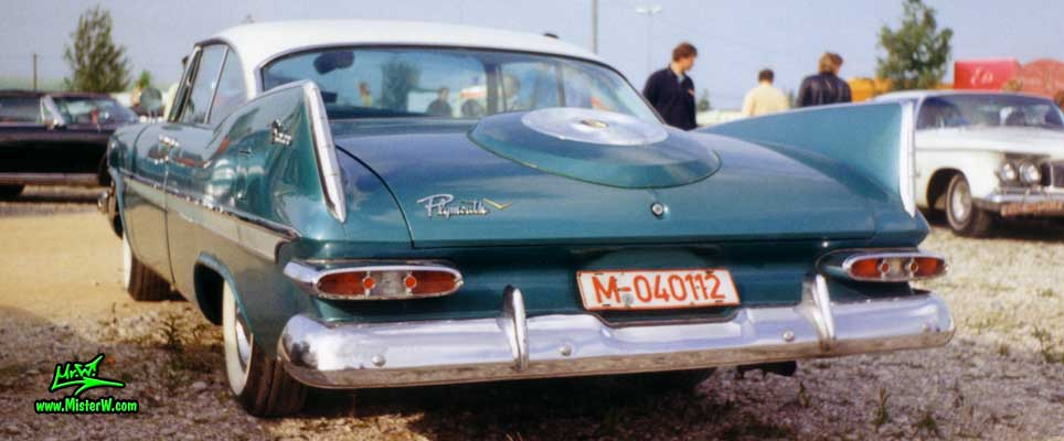 Photo of a turquoise 1959 Chrysler Plymouth Belvedere 2 Door Hardtop Coupe at a classic car meeting in Germany. 1959 Chrysler Plymouth Fins