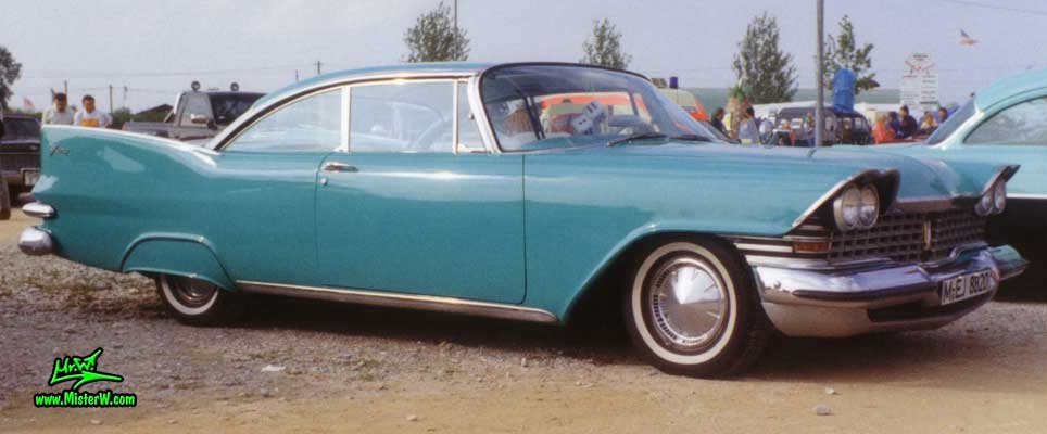 Photo of a turquoise 1959 Chrysler Plymouth Fury 2 Door Hardtop Coupe at a classic car meeting in Germany. 1959 Plymouth Fury Coupe with Fender Skirts