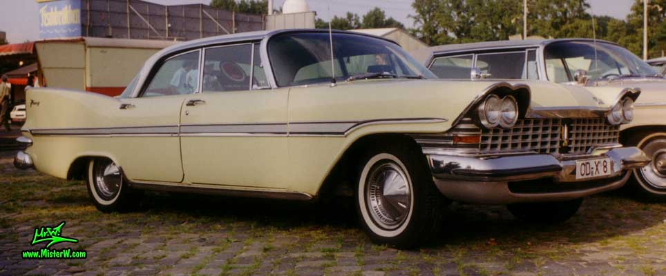 Photo of a cream colored 1959 Chrysler Plymouth 4 Door Hardtop Sedan at a classic car meeting in Germany. 1959 Plymouth Sedan