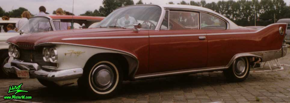 Photo of a dark red 1960 Chrysler Plymouth Fury 2 Door Hardtop Coupe at a classic car meeting in Germany. 1960 Plymouth Fury Coupe