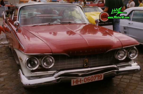 Photo of a dark red 1960 Chrysler Plymouth Fury 2 Door Hardtop Coupe at a classic car meeting in Germany. 1960 Plymouth Fury Frontview