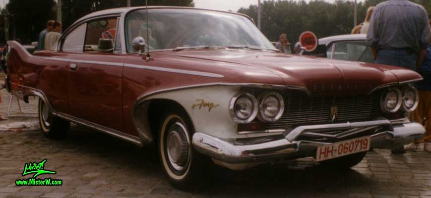 Photo of a dark red 1960 Chrysler Plymouth Fury 2 Door Hardtop Coupe at a classic car meeting in Germany. 1960 Plymouth