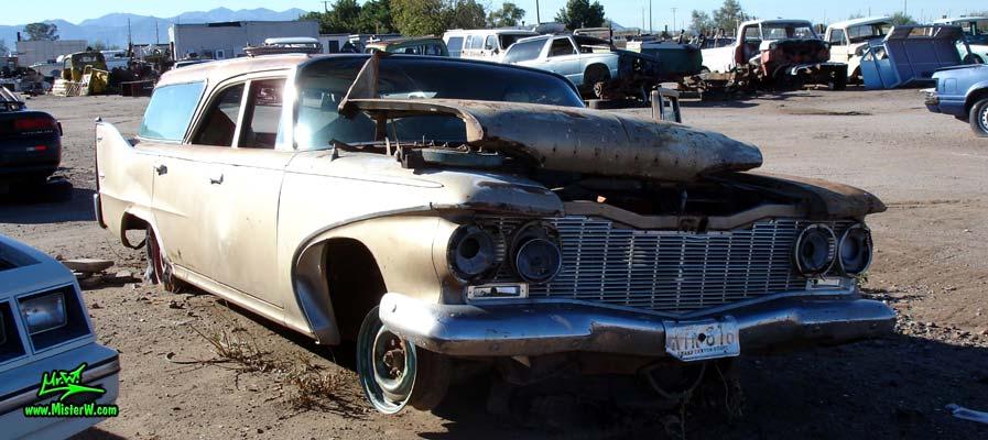 Photo of a 1960 Plymouth Custom Suburban 4 door 6 passenger station wagon at a junk yard in Phoenix, Arizona. Front view of a 1960 Plymouth Custom Suburban 4 door stationwagon