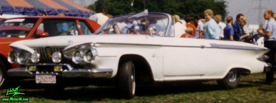 Photo of a white 1961 Chrysler Plymouth Fury Convertible at a classic car meeting in K�ln Chorweiler (Cologne), Germany. 1961 Plymouth Fury Convertible